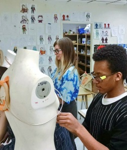 Project Runway finalist Amanda Valentine mentors an MHS student on his PBL spacesuit design.