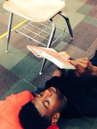 S reading on floor
